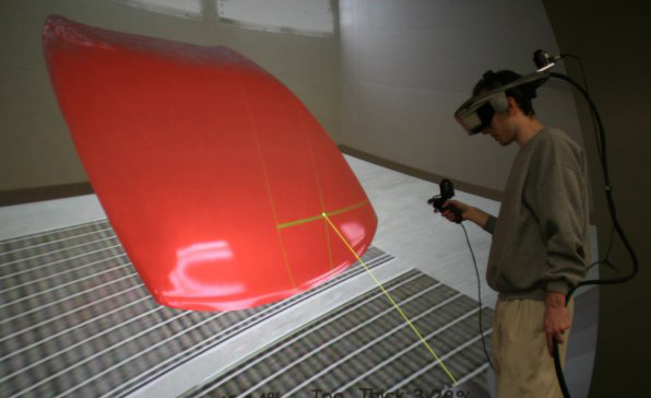 The end result of using the system to spray paint a car hood. Both directionally diffuse and gloss layers have been applied. In this case, a photorealistic image of how the paint would look when dry is displayed to the user. Useful information such as overspray, and percentage covererage is given to the user. This makes the system ideal for training, as both visual and numeric feedback is given to the trainee.